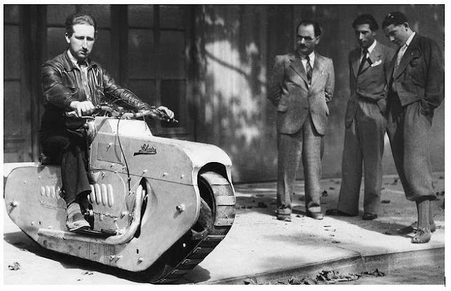 Tracked Motorcycle, 1938, of  J Lehaitre, Paris. Speed 25 m.p.h. Steering was accomplished by handlebars which controlled a sideways motion of the drive belt. From Modern Mechanix, Feb 1938
