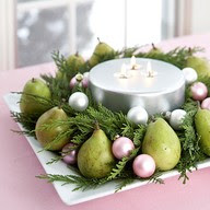 pears and pink ornaments with cedar and candle Christmas table