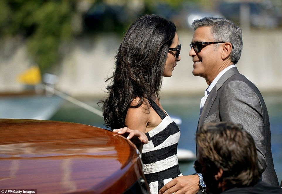 Amal Alamuddin arrives in Venice in a Dolce & Gabbana striped monochrome dress