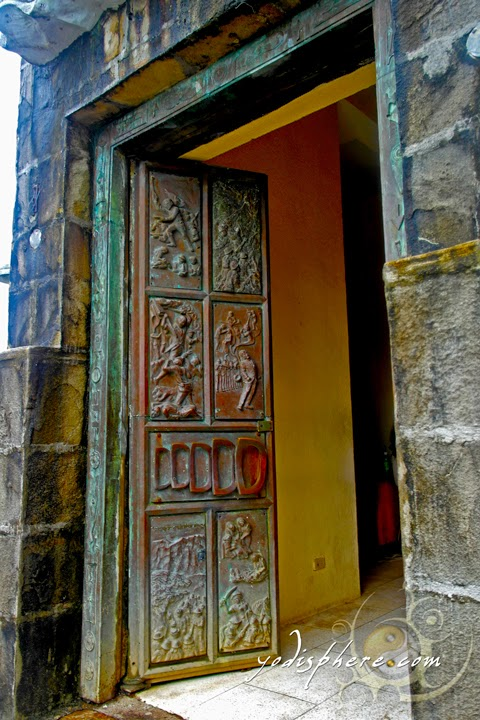 Carved doors going inside the Memorial Cross