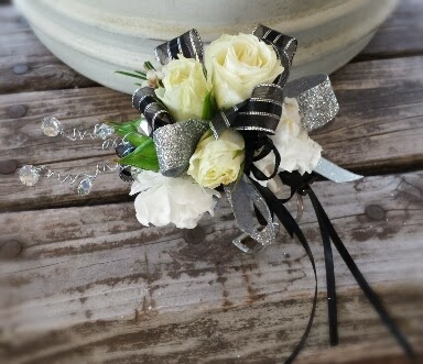 Silver & black on a silver cuff- with white roses and stock