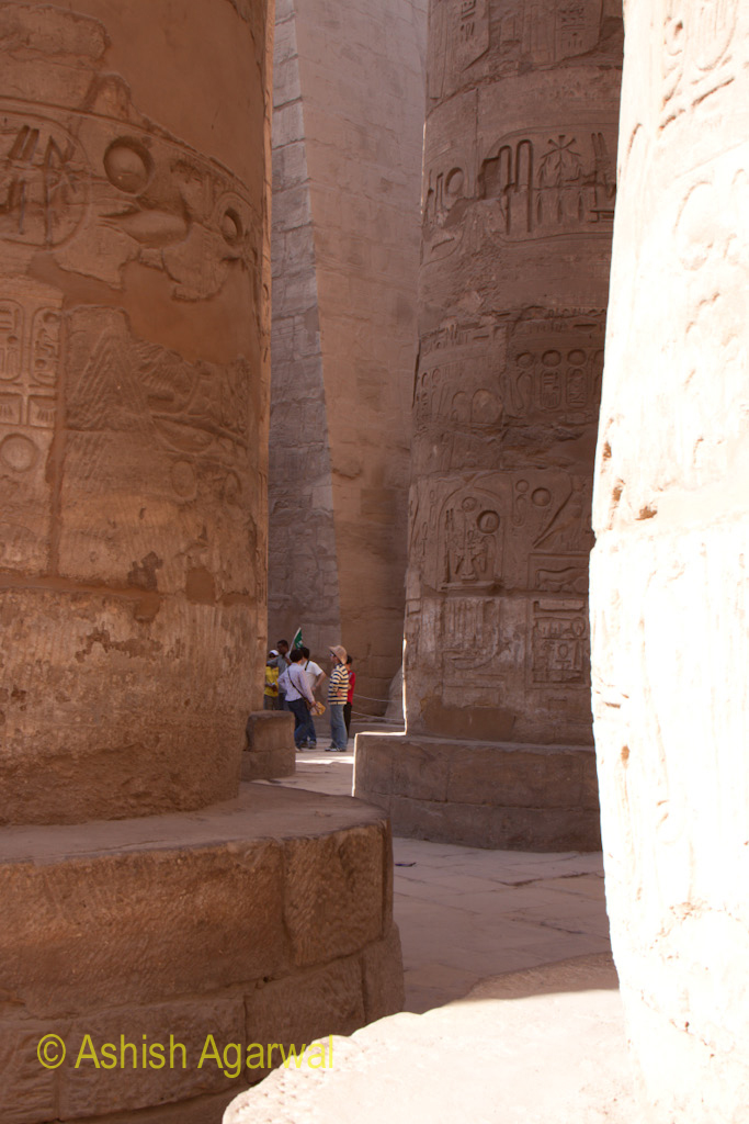 View of tourists at the base of the pillars of the Hypostyle Hall in the Karnak temple