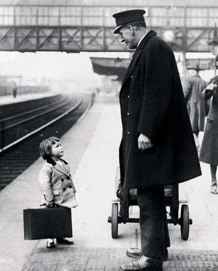 A young passenger asks a station attendant for directions. Bristol Railway Station