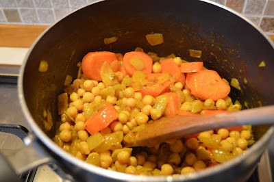 Chickpeas added to the pan