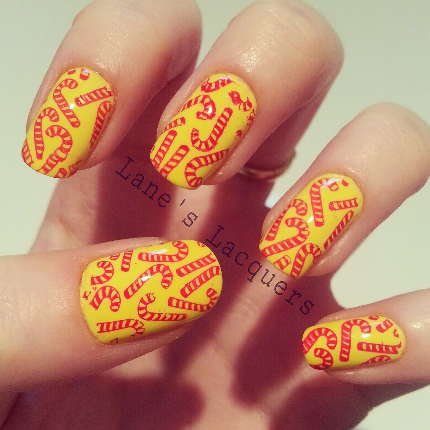 ciate-big-yellow-taxi-candy-cane-xmas-nail-art