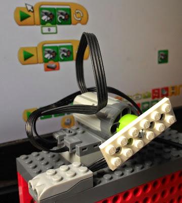 Photo of the Wedo motor speed block and distance sensor experiment setup