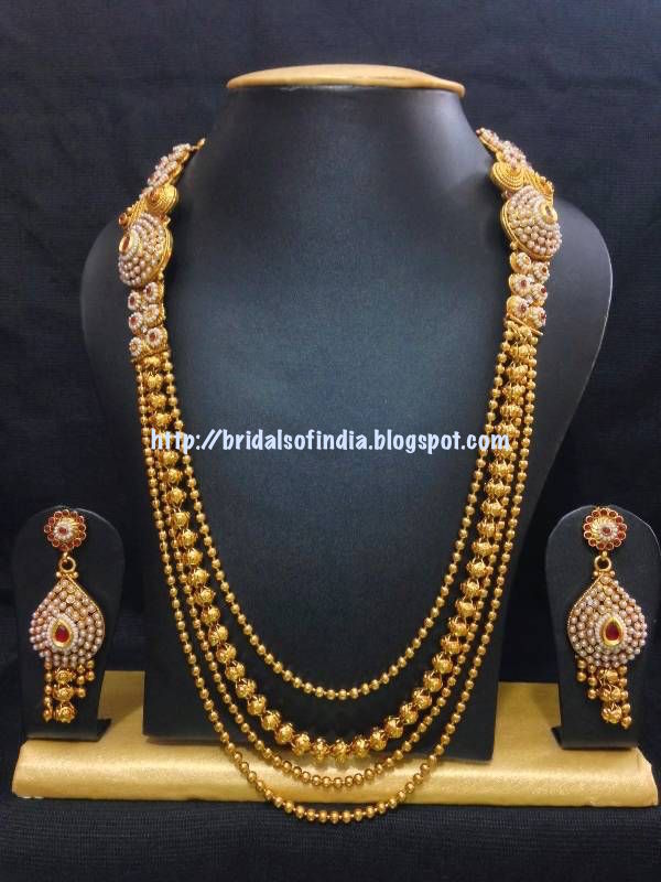 Fashion world: Traditional haram jewelry set in gold with red stones