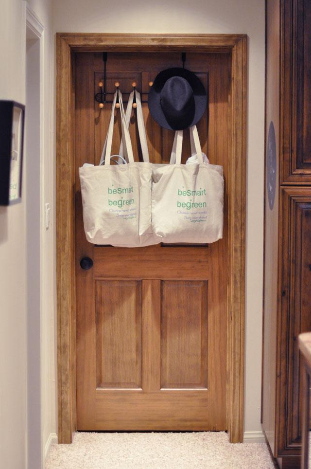 wood door, hooks, canvas bags hanging