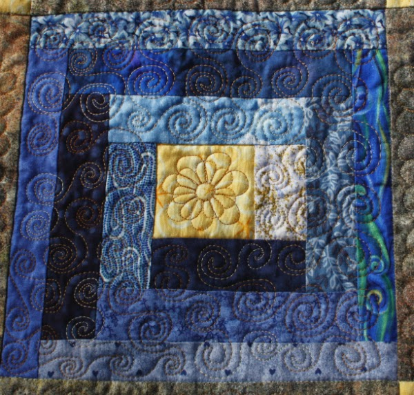 Spiral free motion quilting
