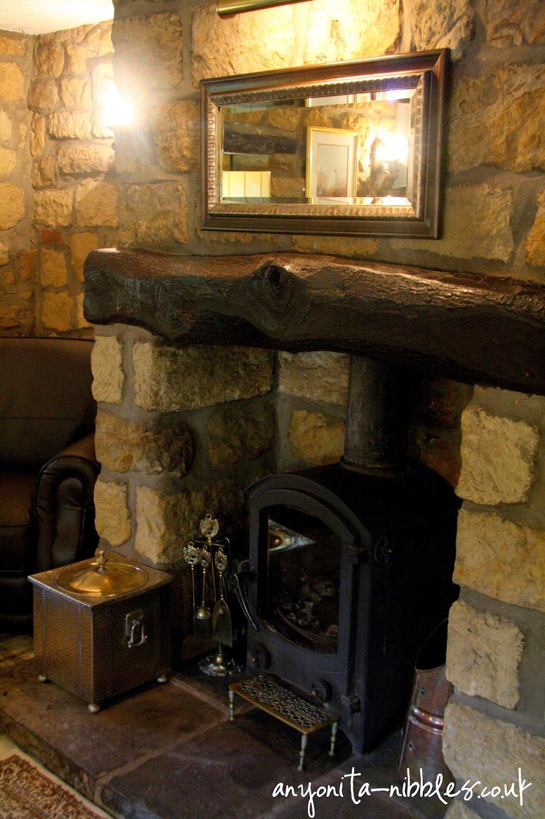 Welcoming and cosy fireplace at Ox Pasture Hall Hotel | Anyonita-nibbles.co.uk