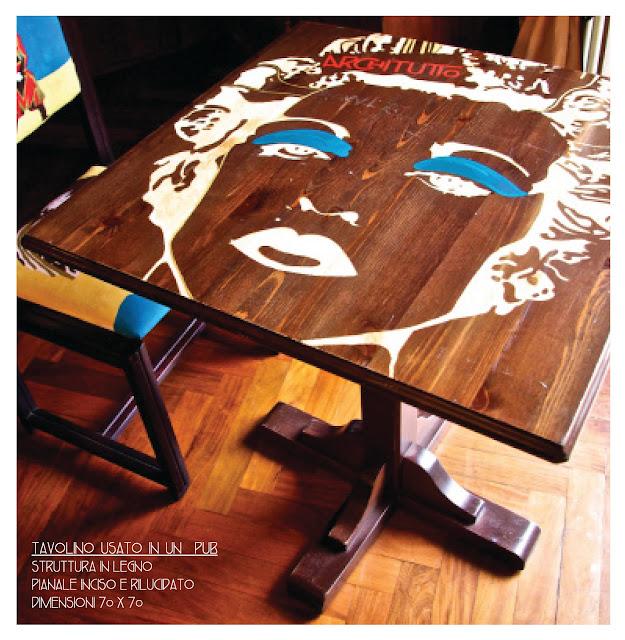 vecchio tavolo di un pub rivalorizzato tramite stampa artistica incisa sul pianale