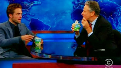 Robert Pattinson gets cosy with Jon Stewart