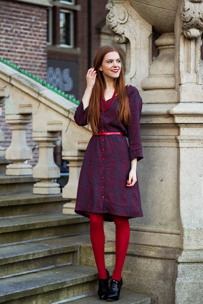 Retro style fashion blogger outfit with red tights and button up dress