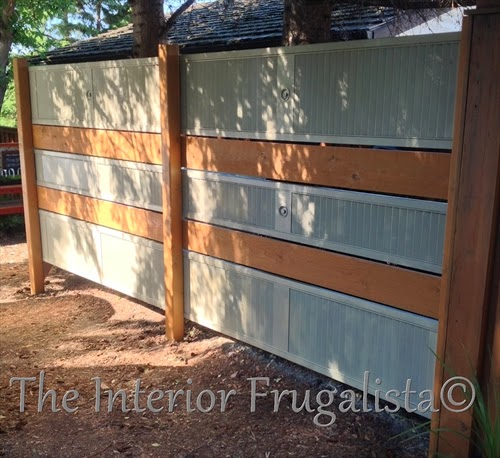 Old louvered bi-fold doors turned into a garden screen