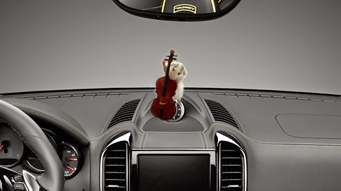 image of a mouse playing a miniature bass on top of a car dash