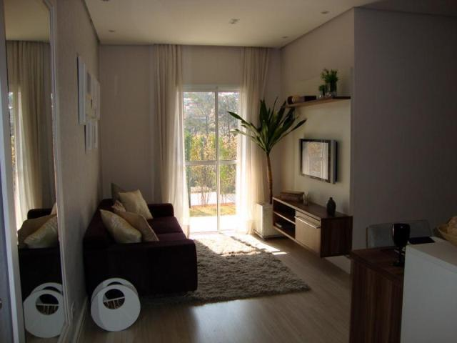 do apartamento e detalhe do papel de parede que o charme da sala