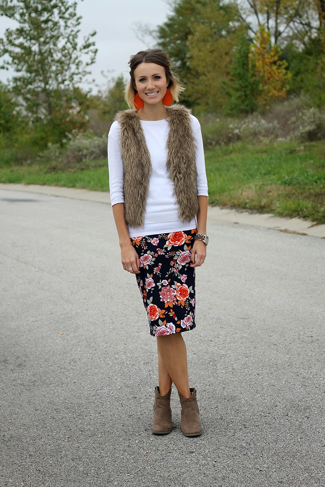 Floral pencil skirt, fur vest, and ankle boots