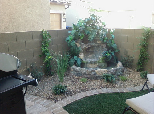 Water Features For Backyards Pictures :  block wall, barbecue grill, recliner and a waterfall in the corner
