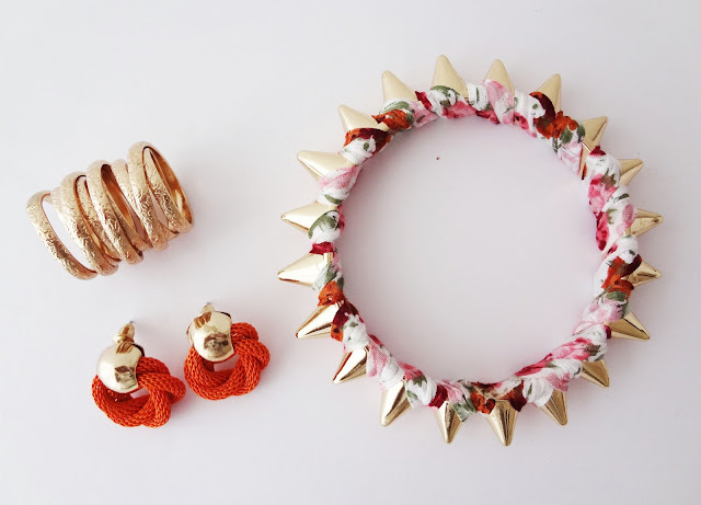 SIX bright orange earrings €5.95, gold twisted ring €5.95 and gold spike wrapped floral bangle €6.95.