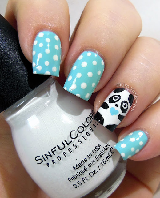 dotted manicure with panda accent nail