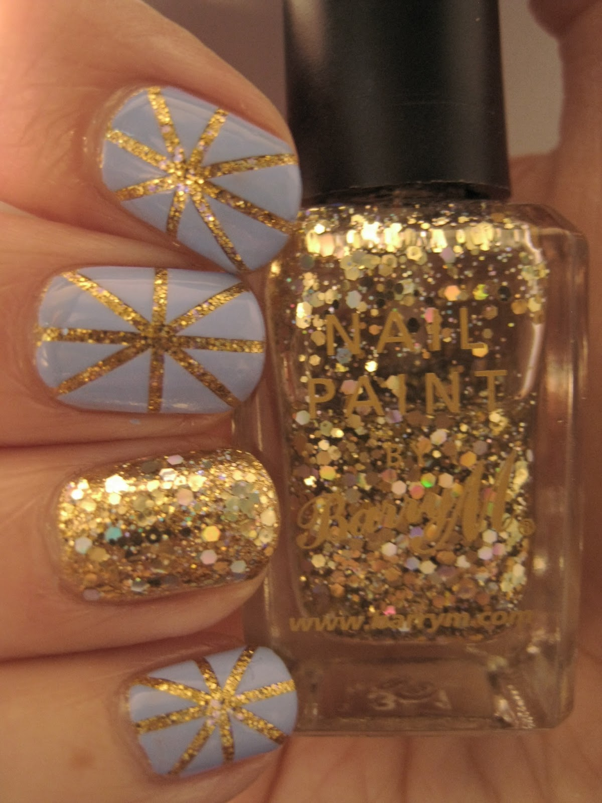 Naily perfect: Gold glitter and blue tape mani