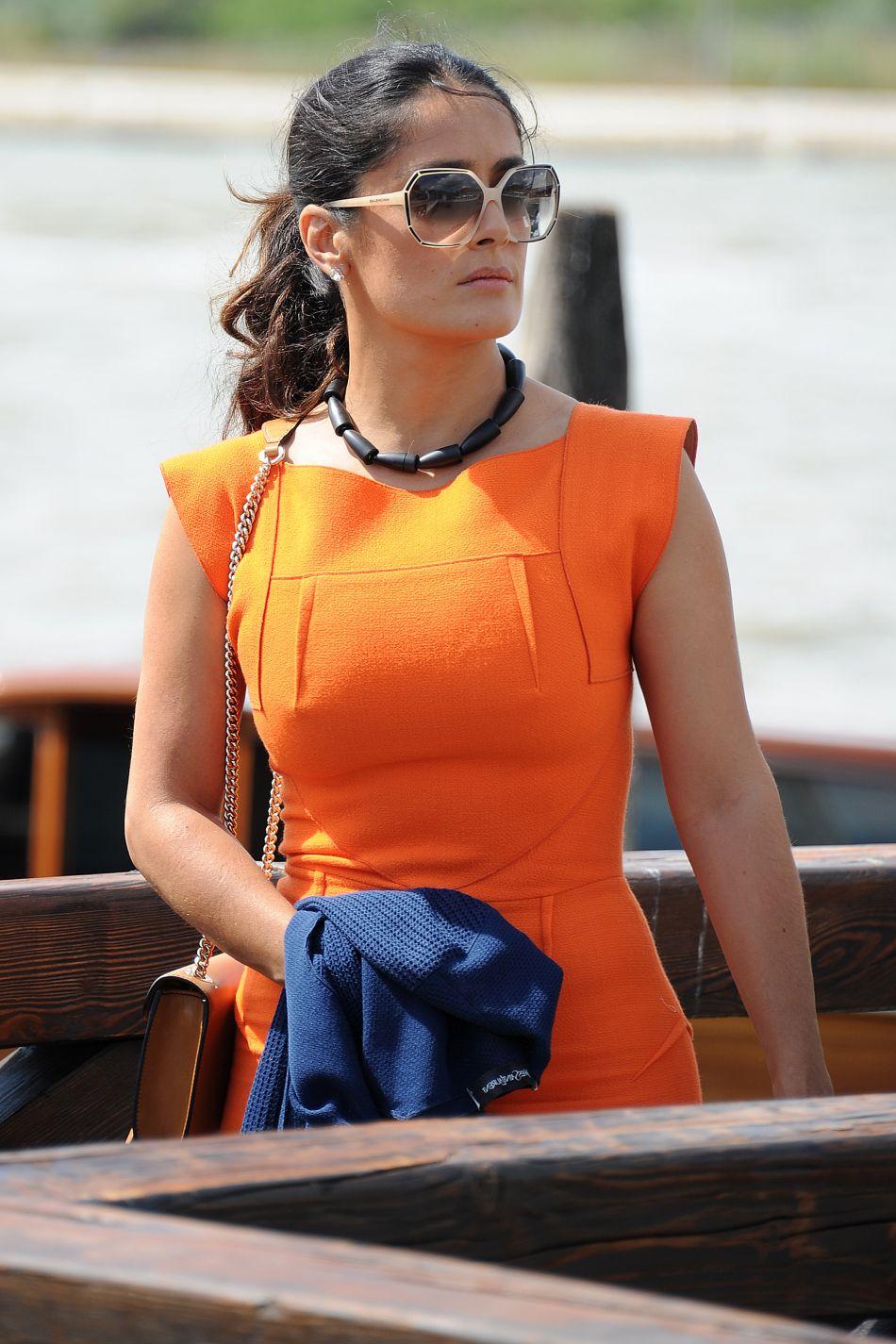 salma hayek in orange dress with her former husband and