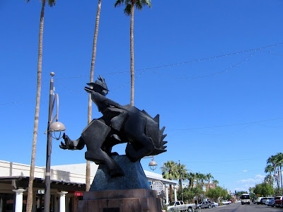 statue of a cowboy riding a bucking bronco in old town scottsdale