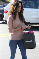 Eva Longoria holding a bag from Zadig and Voltaire