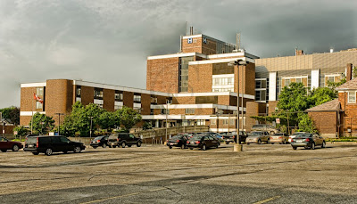 The Orillia Soldier's Memorial Hospital and the main parking area under stormy skies