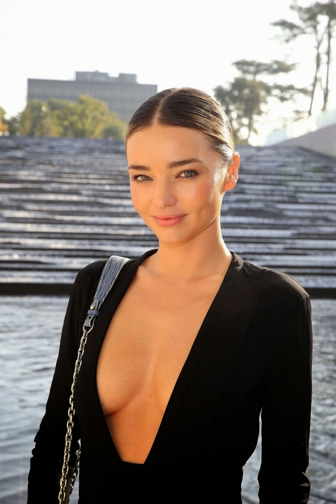 Miranda Kerr shows off plunging LBD at the Louis Vuitton Spring/Summer 2015 Paris Fashion Week Show