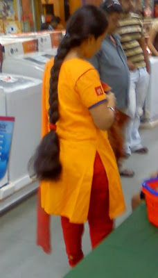 Very thick and long braided Asian women at a super market.