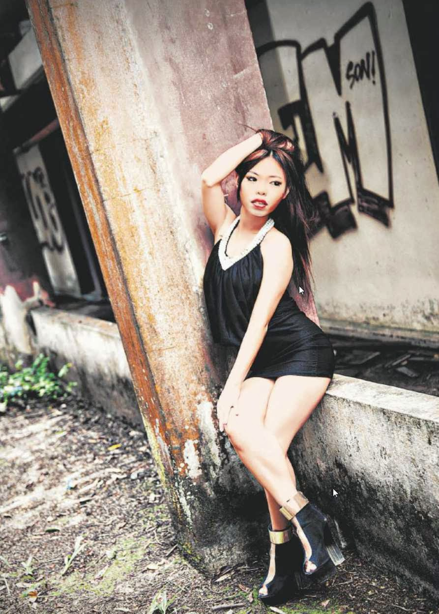STANDING BY WHAT SHE DOES: Angie Ng is the first Singaporean to join the ranks of teachers on controversial language site Sexy Mandarin. She says her job, which entails the teachers posing in lingerie or revealing outfits, boosts her self-confidence.