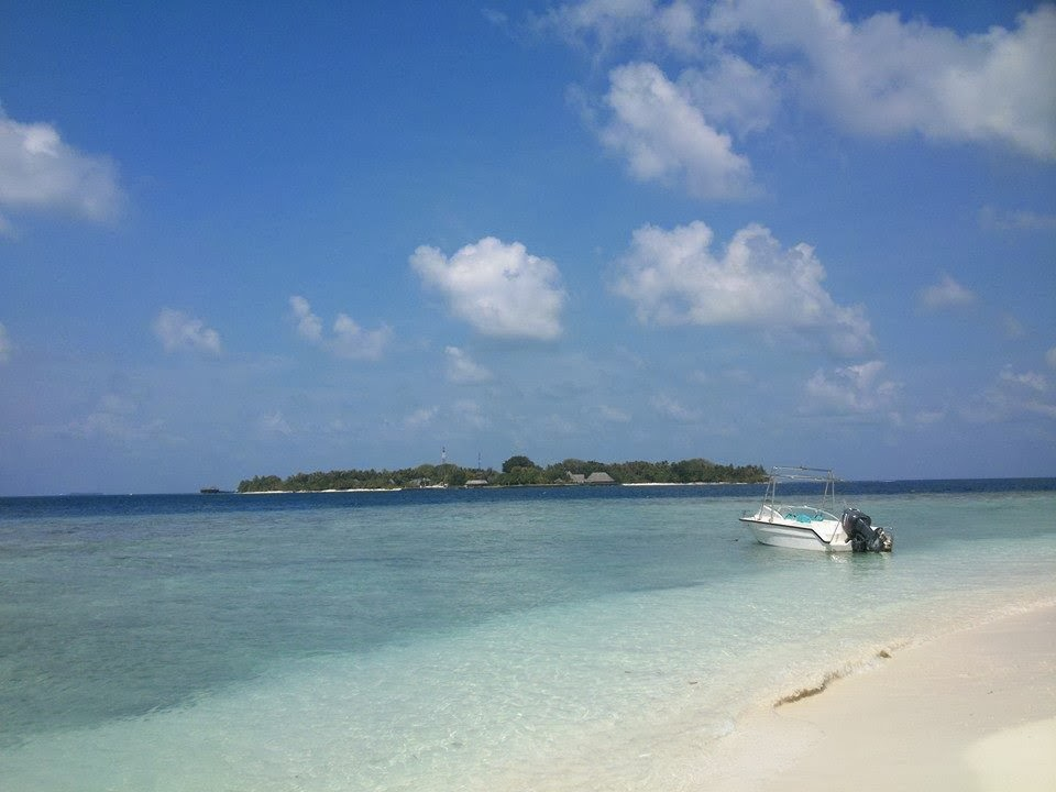 Male Beach with island Boat
