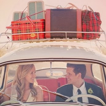 Couple in Car with Luggage