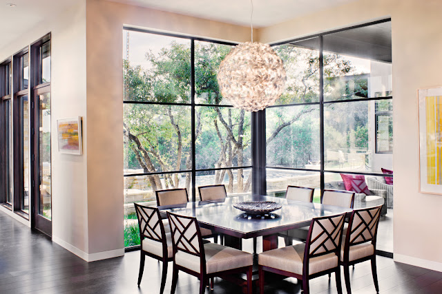 Photo of square dining table by the glass wall in the dining room