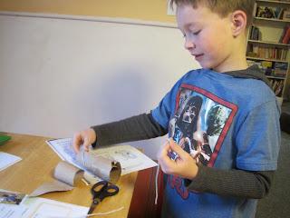 Dash making a cardboard telescope.