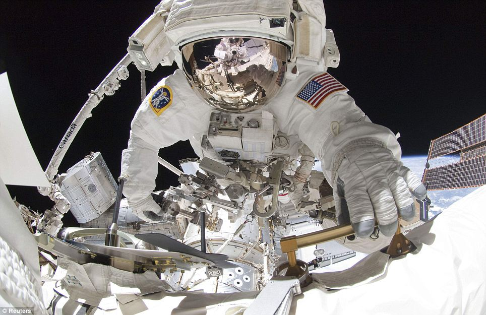 Final spacewalkers of Nasa's 30-year shuttle mission