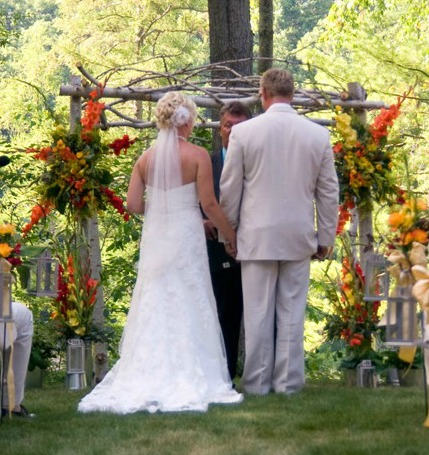The talented groom made the wedding arch from tree branches found on his