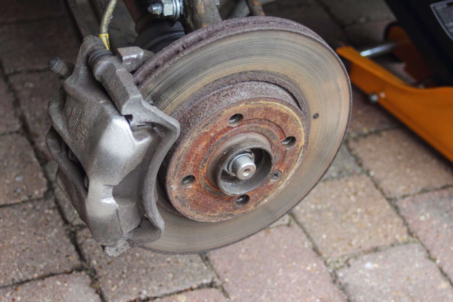 Old brake disc showing wear and rust