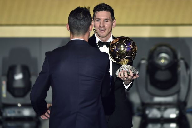 Winner: Messi is congratulated on his Ballon d'Or success by Ronaldo