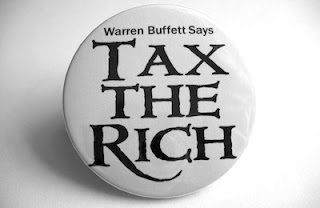 Warren Buffet says he believes in the future of US newspapers and wants the rich to pay more in taxes.