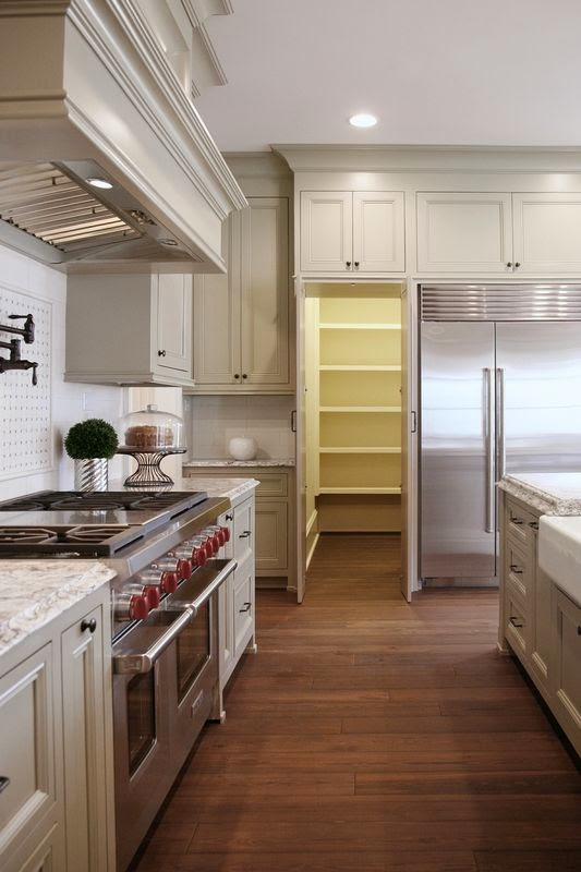 The cow spot homes of distinction kitchen for Hidden pantry