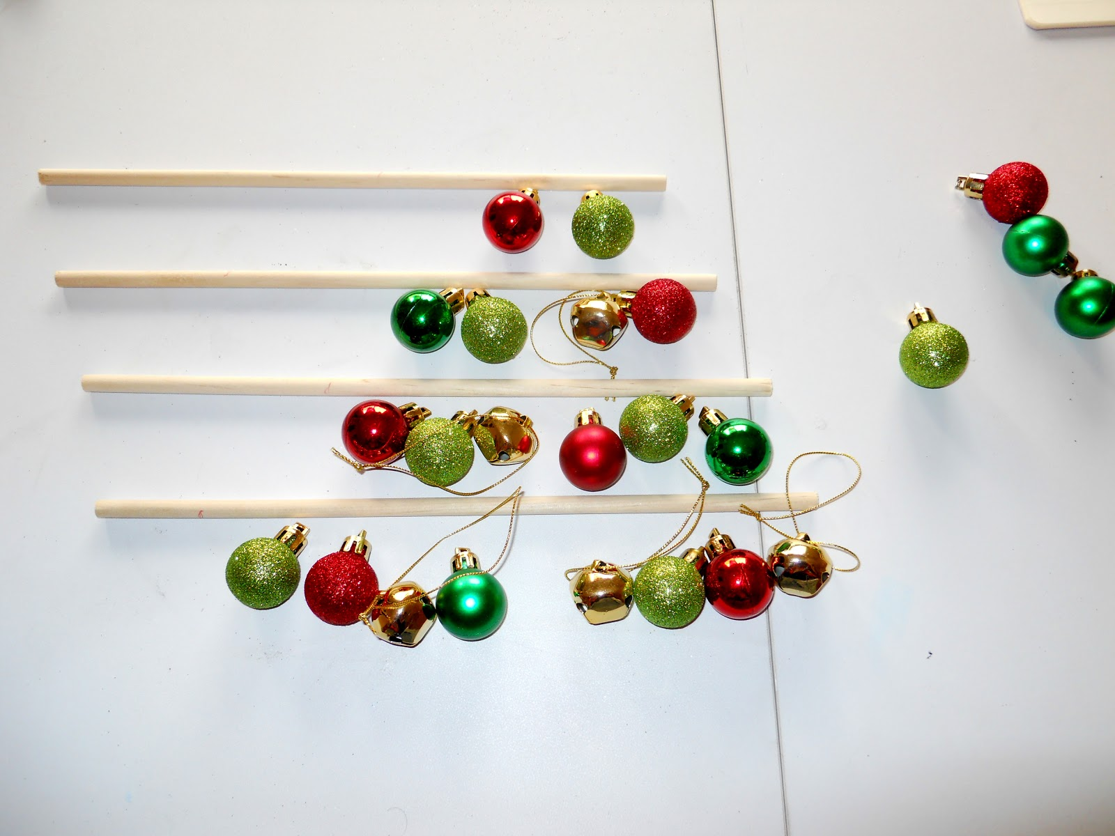 Tiny christmas tree ornaments - First Lay Out How You Want Your Ornaments Arranged So That You Know Where To Cut Your Dowels I Wanted Four Rows So I Did 8 Bulbs On The Bottom Then 6