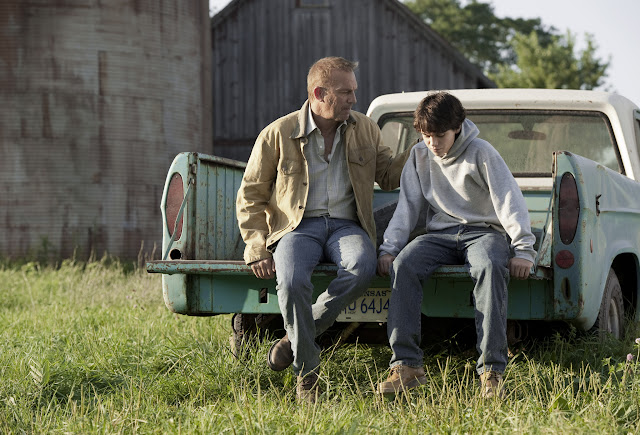 Man of Steel KEVIN COSTNER as Jonathan Kent and DYLAN SPRAYBERRY as Clark Kent