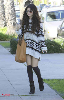 Selena Gomez Stills with Knee High Stockings and Heart Shaped Sungles Filling up her car in LA