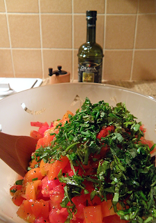 Bowl of Tomatoes Topped with Herbs and Garlic