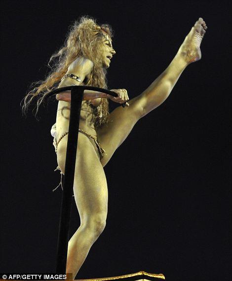 Golden girl: A reveller of Academico do Salgueiro samba school performs on top of a float.