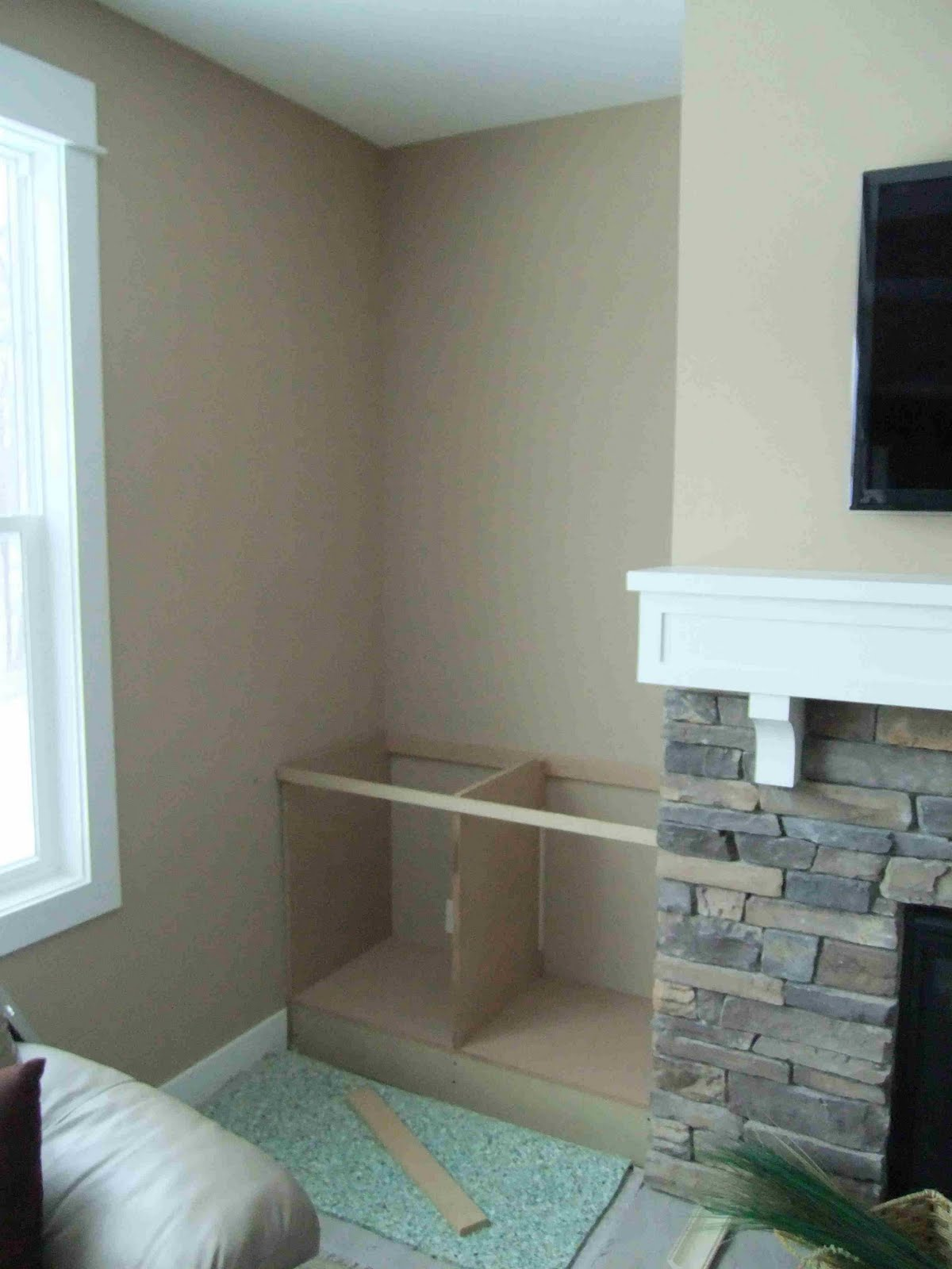 building built in cabinets next to fireplace