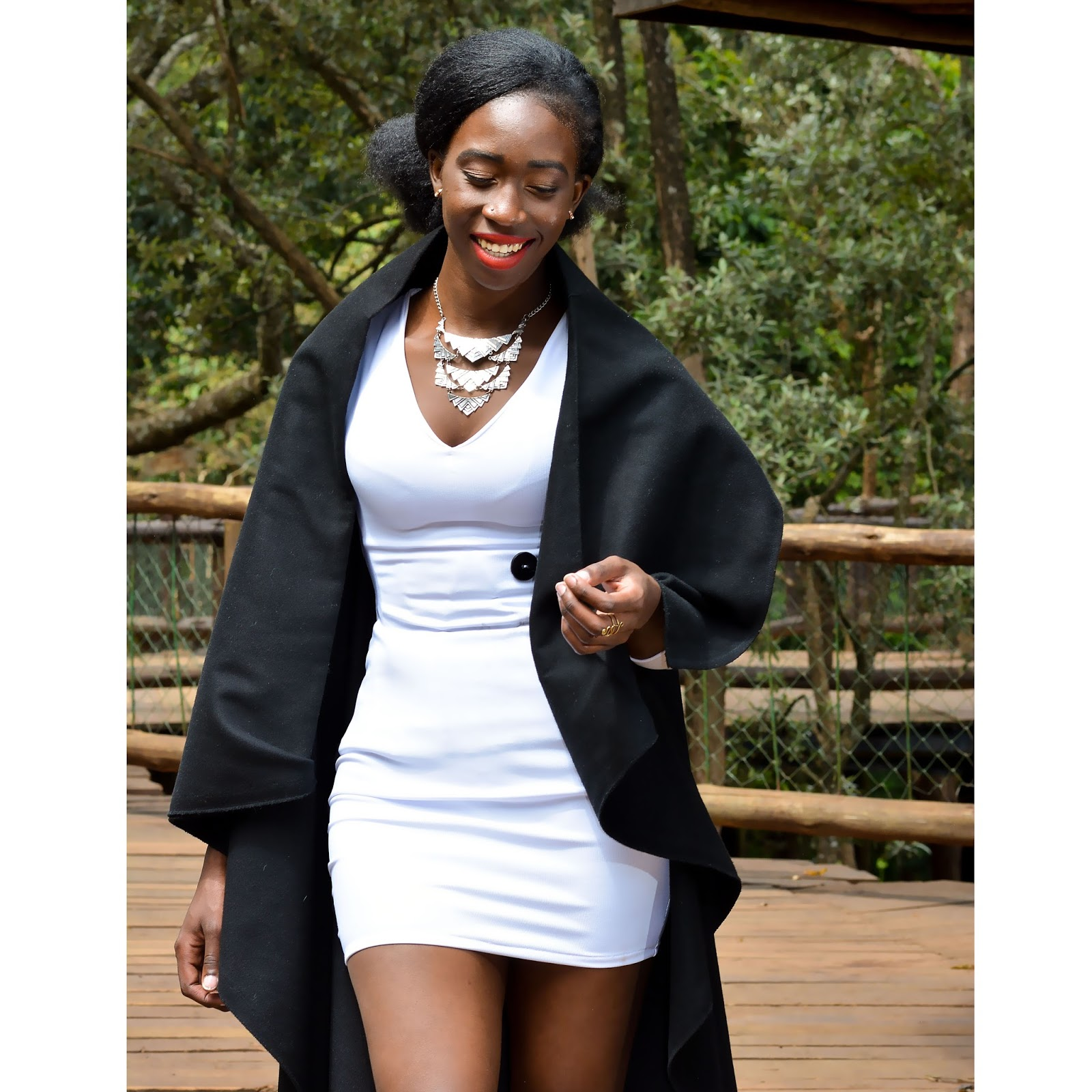 style with ezil, waterfall trench, what to wear over a little white dress, trench coats, wrap sweaters,African fashion blogger, Kenyan fashion blogger,  what to wear to a night out. ootn, black trench coat.