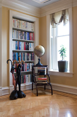 built in book racks with unique steps table and elephant foot unbrella container